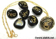 Picture of Black Sanskrit Tumble stone set with golden cage necklace